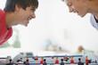 Teenagers playing foosball together