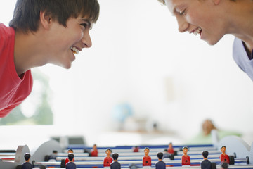 Teenagers playing foosball together