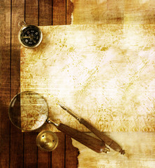 Compass and magnifier on textured paper