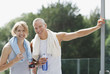 Smiling couple drinking water after exercise