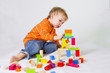 2 years old baby boy playing with wooden blocks