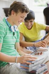 Teenage boys looking at cd roms