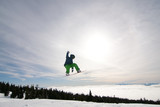 Male Snowboarder Catches Big Air.