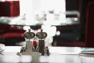 Salt and pepper shakers on restaurant table