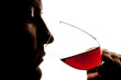 Silhouette of man degusting wine