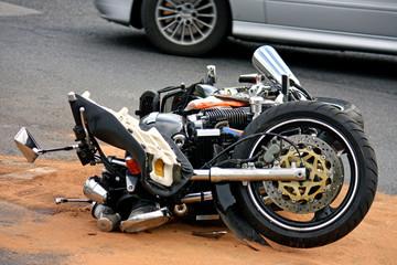 black motorbike accident on the asphalt road