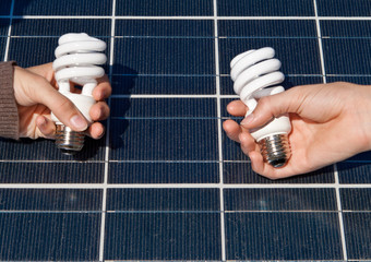 Hands Compact Fluorescent Light Bulbs Solar Panel
