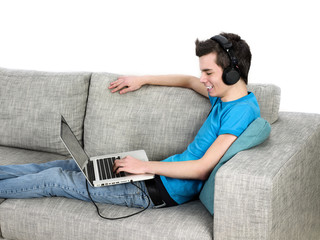 young man listening to music on his laptop