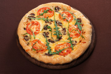 Pizza with mushroom and tomatoes