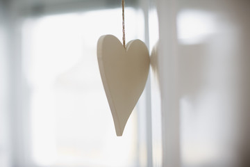 Close up of white heart ornament