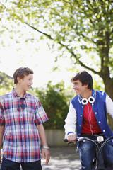 Smiling teenage boys with bicycle