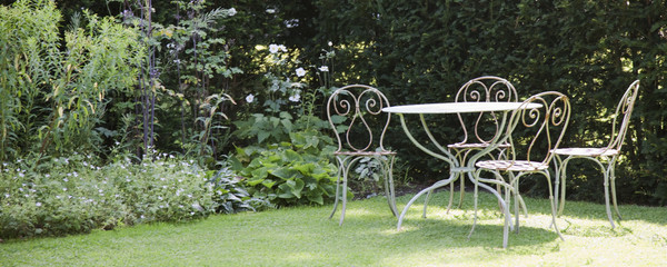 Garden table and chairs in backyard