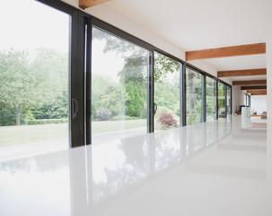 Modern kitchen and glass walls to backyard