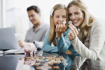Mother and daughter comparing coins