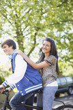 Teenage boy riding girlfriend on bicycle