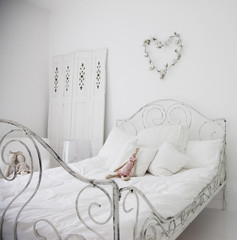 """White, old-fashioned bed in elegant bedroom"""