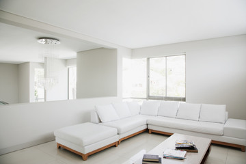 White sofa and mirror in modern living room