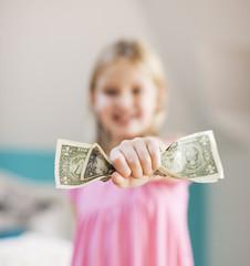 Girl holding one dollar bills