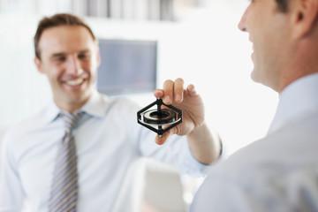 Businessman holding gyroscope