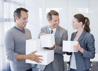 Business people holding cubes