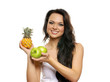 Portrait of a young and attractive woman with fresh fruits