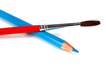 blue pencils and brush for paints
