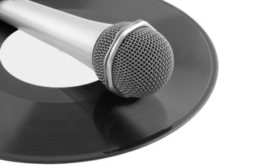 Microphone laying on vinyl records isolated