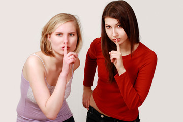 Girls finger on lips quiet or secrecy gesture