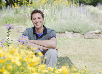 Smiling man sitting in park