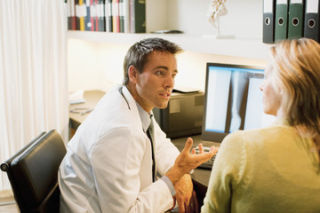 Doctor talking to patient in doctor?s office