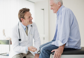 Doctor checking patient?s reflexes in doctor?s office