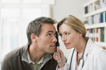 Doctor examining patient?s eye in doctor?s office