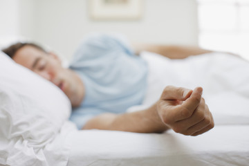 Sick man sleeping in bed