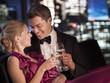 Elegant couple drinking Champagne at night