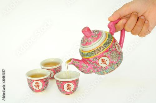Pouring Hot Tea Into A Tea Cup