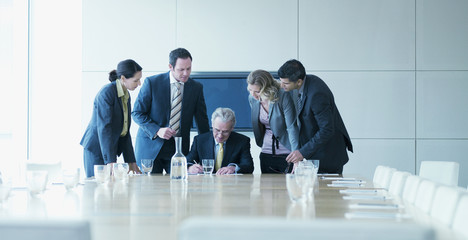 Business people watching boss sign contract