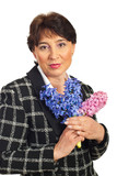 Attractive mature woman holding hyacinth