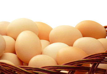 Eggs in a wicker basket isolated on white