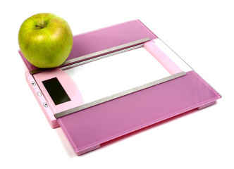 floor scales and green apple