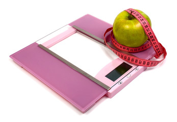floor scales measuring ribbon and green apple