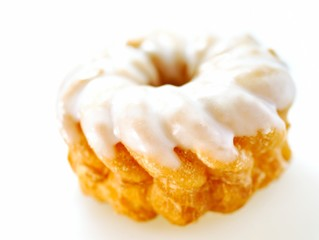 Cruller with icing isolated on white background