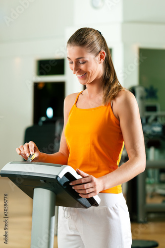 Woman exercising with modern key system