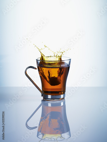 Tea splashing from teacup