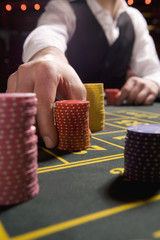 Man betting gambling chips