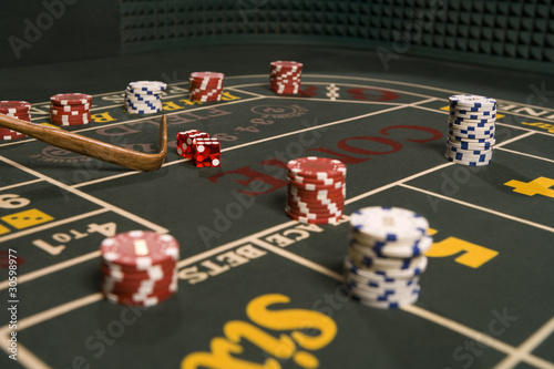Dice and gambling chips on craps table