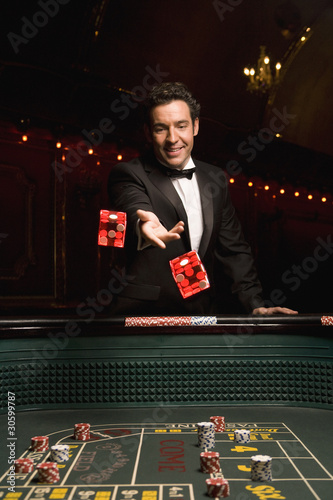 Man throwing dice at craps table