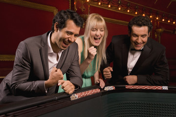 Friends cheering at craps table