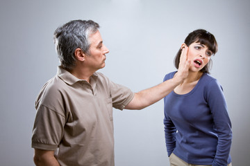 Man slapping his wife face