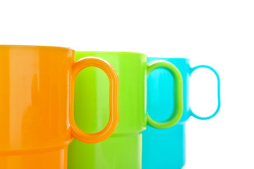 Cups in row isolated on white