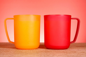Two cups on red background